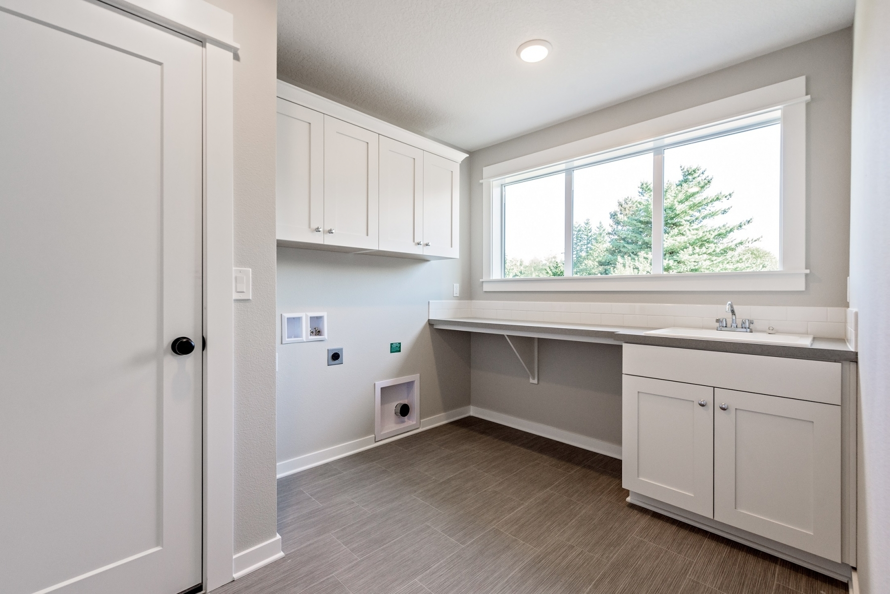 Large Laundry Room with Sink and Folding Counter